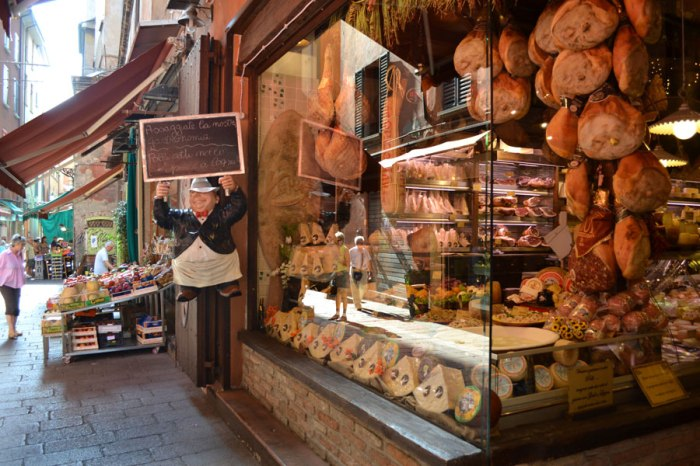 Emilia-Romagna's delicacies on display in the old market area of Bologna