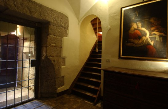 The entrance area with a glimpse of the wooden stairs carrying you to the living room upstairs
