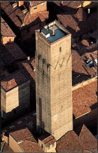 The Prendiparte Tower stands out against Bologna's red rooftops