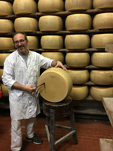 Giuliano Ugoletti of Latteria Campola with the hammer used to check for possible internal flaws of Parmigiano Reggiano.