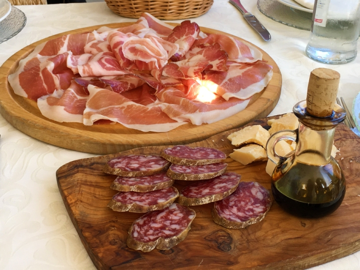 Prosciutto, Parmigiano Reggiano, salame and balsamic vinegar at Restaurant Henry IV near Reggio Emilia.
