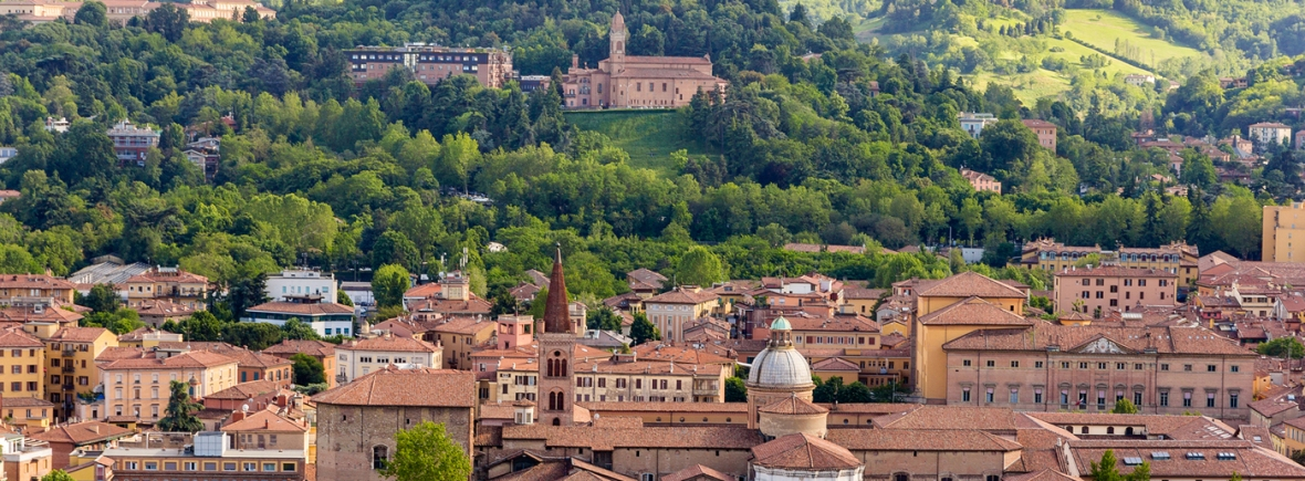 View of Bologna's hills and red roofs from city center