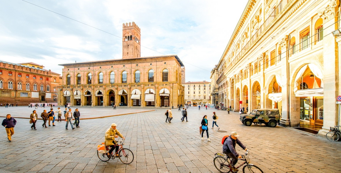 Piazza Maggiore in Bologna with people cycling